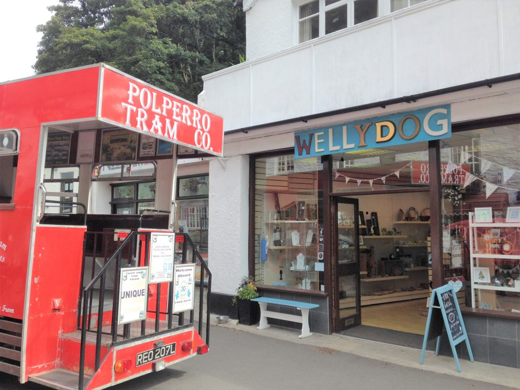 A image of the Wellydog shop in Polperro with the tram